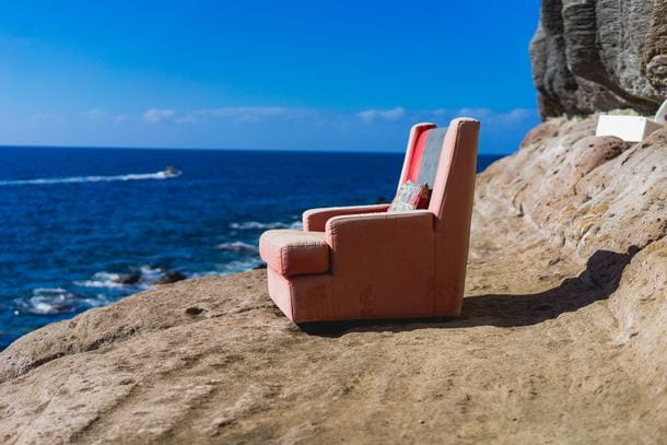 Dirty recliner on the beach